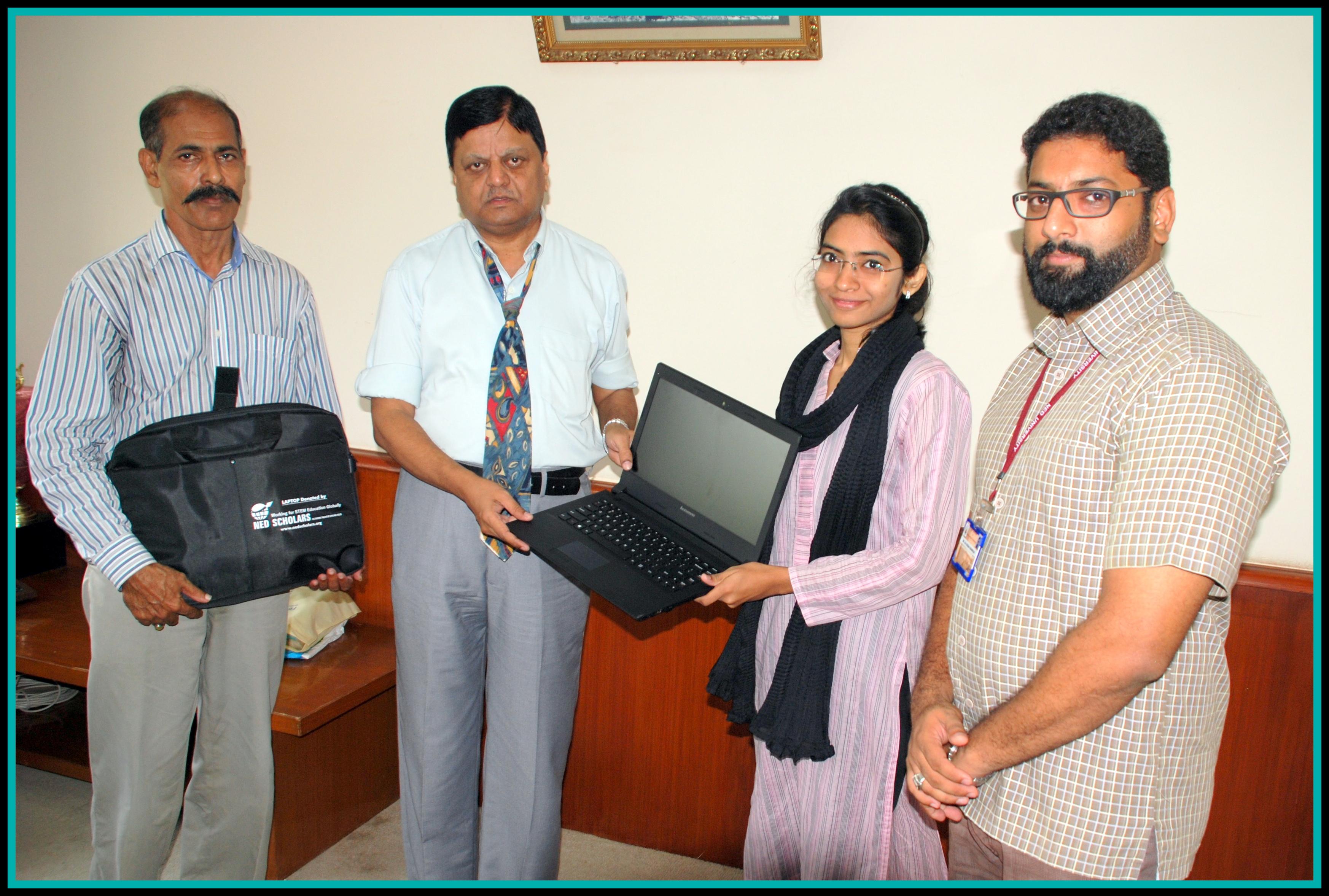 Mahnoor receiving her laptop