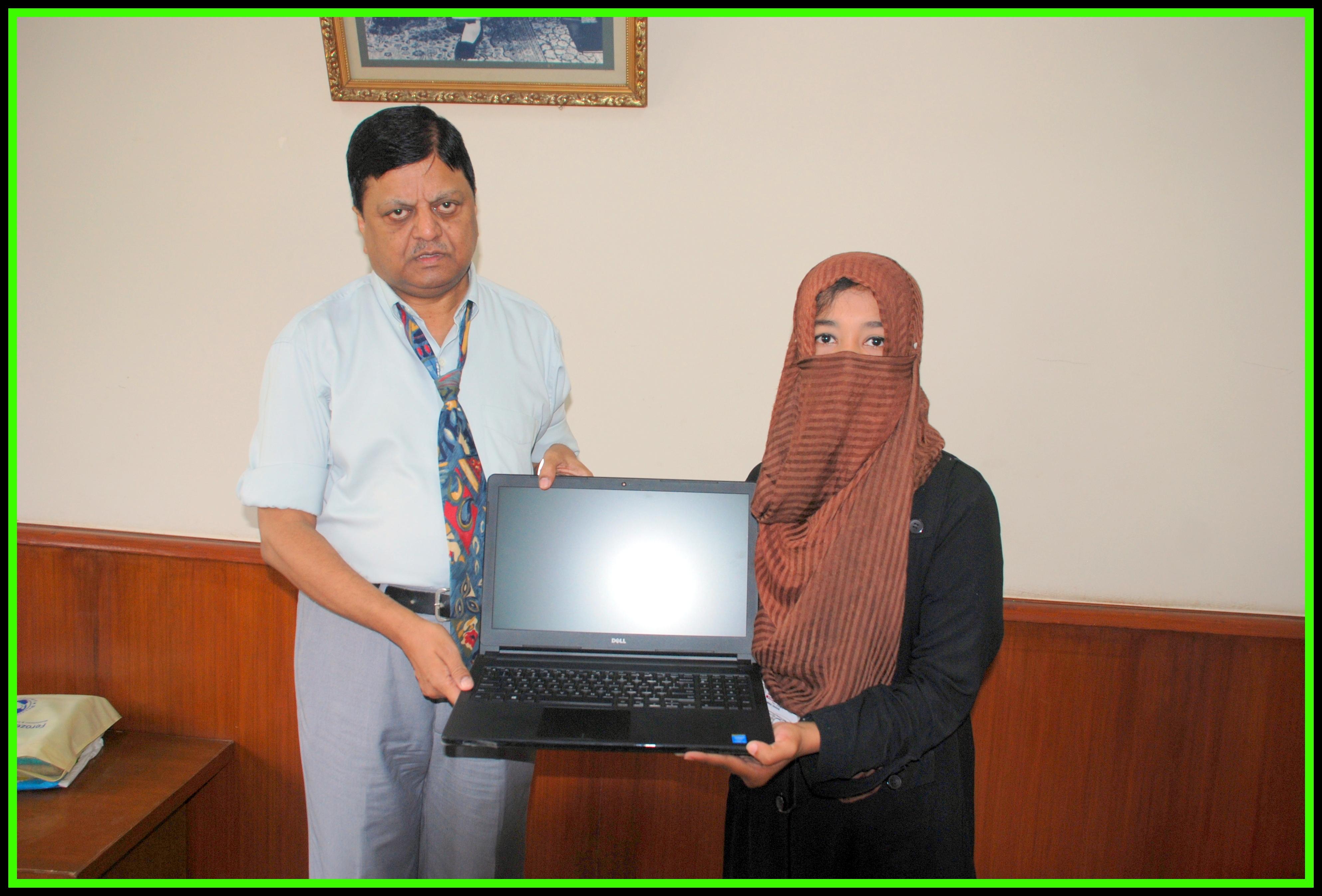 Amna receiving her laptop